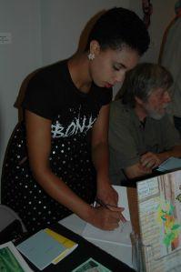 poet Kelsey Harris signs her chapbook